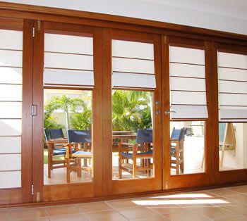 Roman blinds on bifold doors.